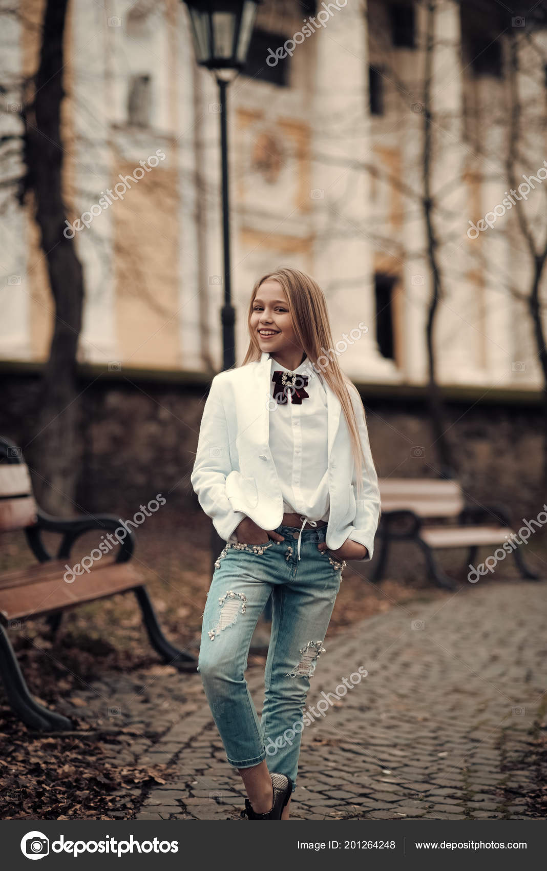 Kid Fashion Trend And Style Girl Smile In Fashionable Jeans In Park