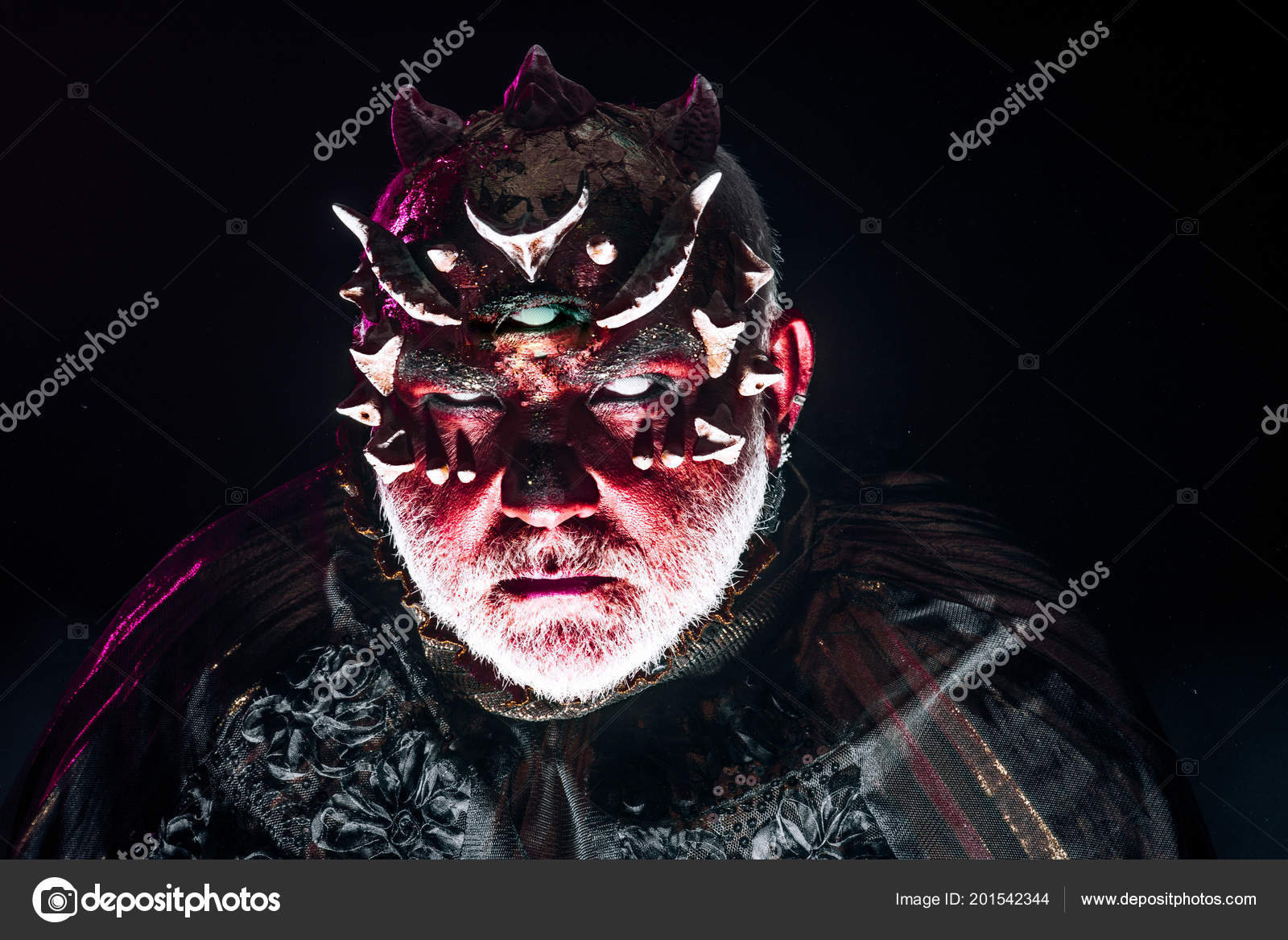 demon face with evil look isolated on black background monster with