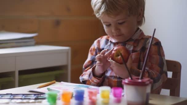 Cute little boy drawing at preschool class.