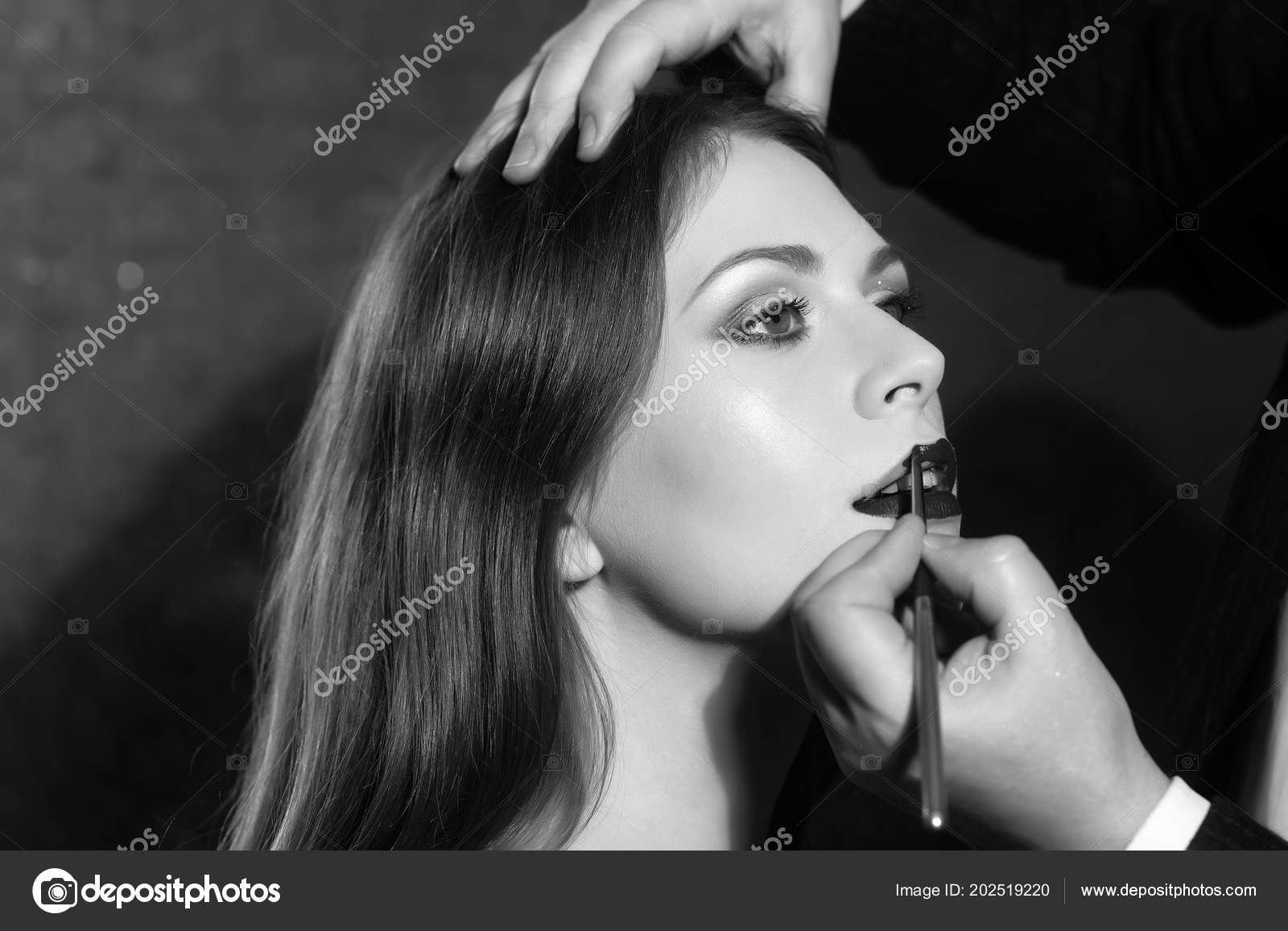 Application of lipstick  fashion model getting lips painted