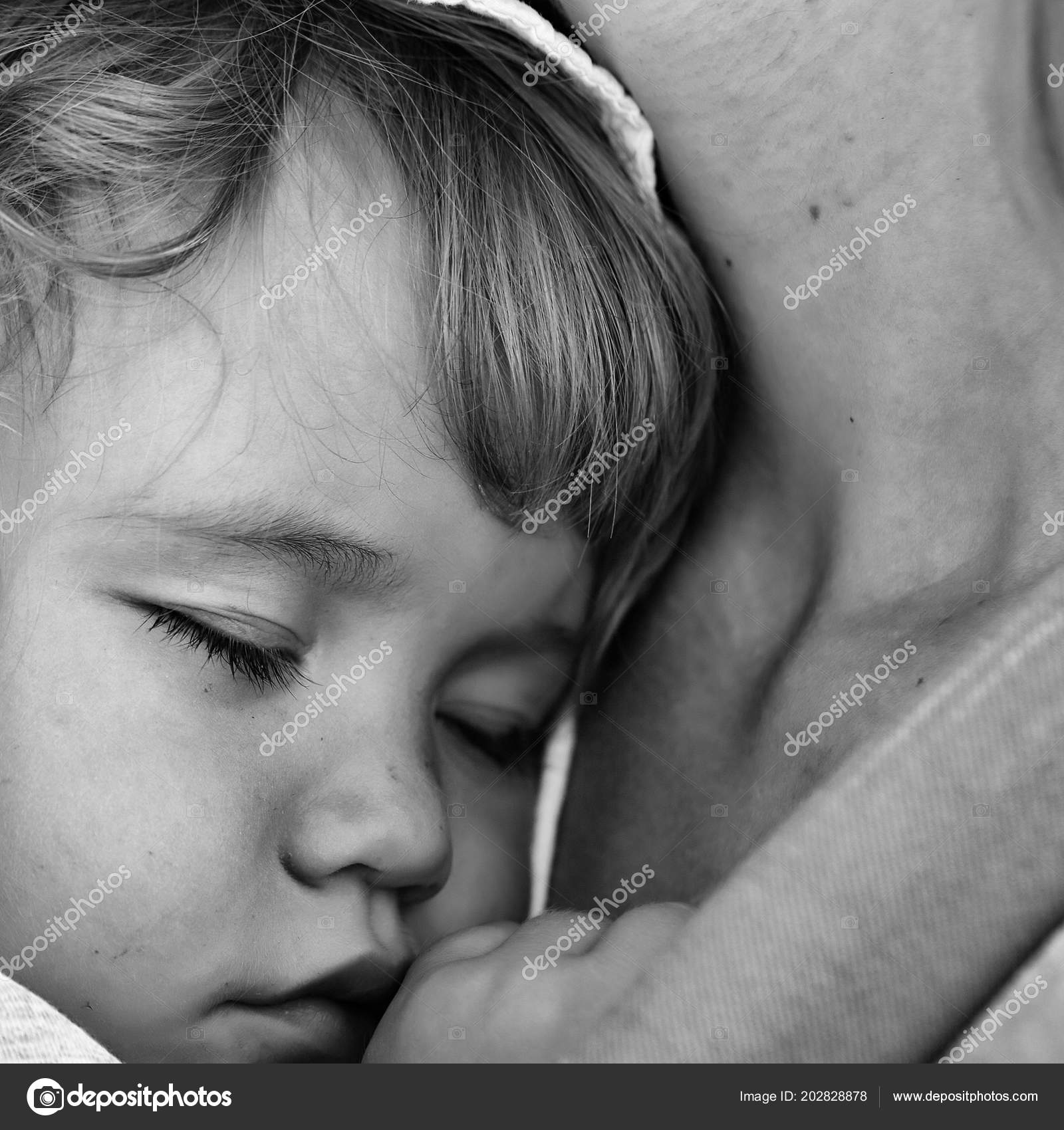 8e68d2f17dc Child is sleeping in the mothers arms. Closeup of cute beautiful carefree  innocent baby boy deep sleeping on hands of mother sunny day outdoor