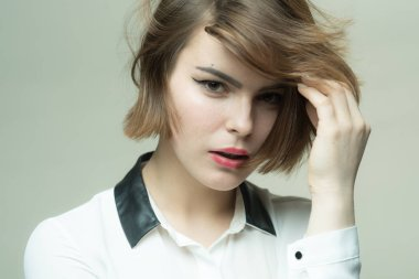 Get right cut for hair type. Cute short hairstyles for women. Short hair styling mistakes avoid. Popularity for short hairstyles like lobs and bobs. Girl mysterious face short hair looking camera