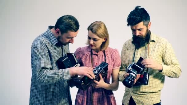 group of people with old cameras concept of the camera guys and