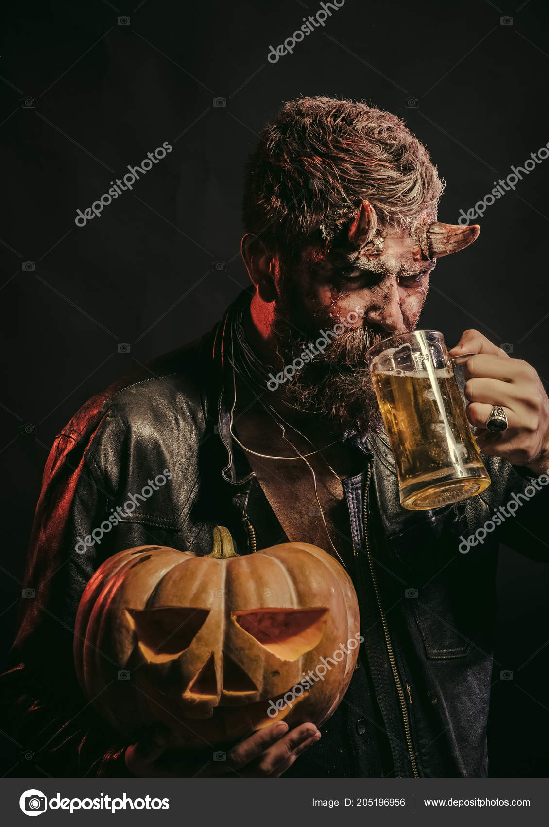Halloween Maan.Halloween Man With Satan Horns Hold Pumpkin Stock Photo