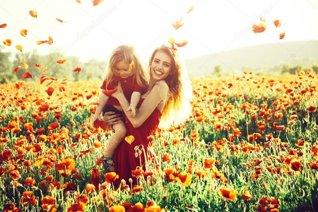 love and family, happy mother and child in poppy field