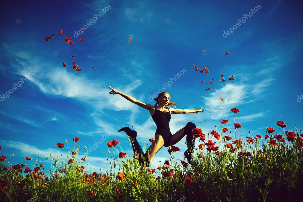 drug and love intoxication, girl jump in field of poppy