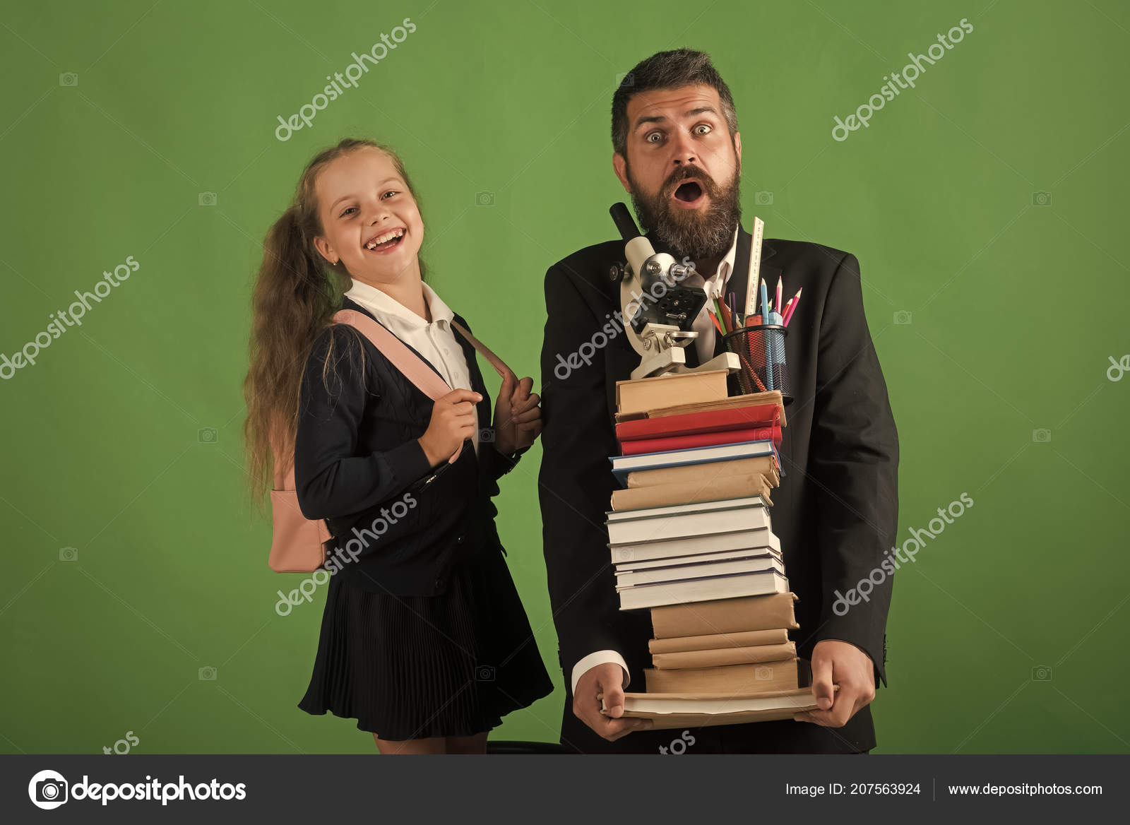Teacher And Schoolgirl With Shocked And Happy Faces Stock Photo
