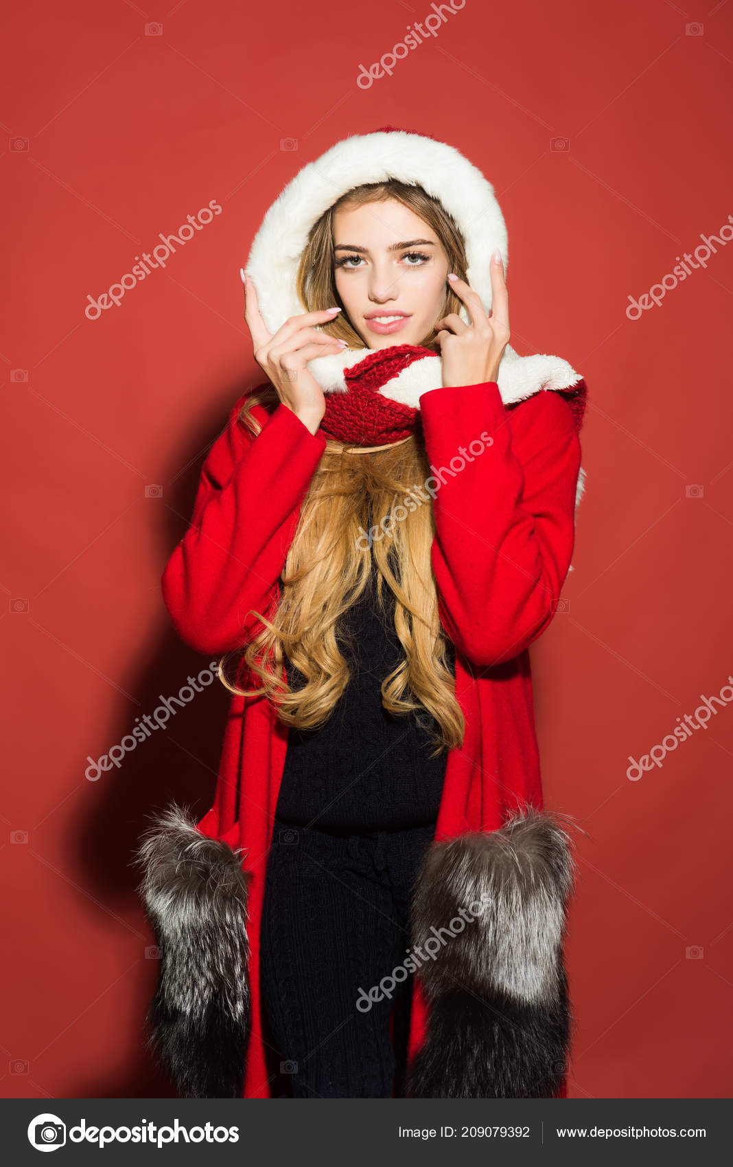 b74e00f31c Woman in santa costume with pretty face. Happy girl celebrate new year on  red background. Christmas woman in red hat. Xmas party and winter holiday.