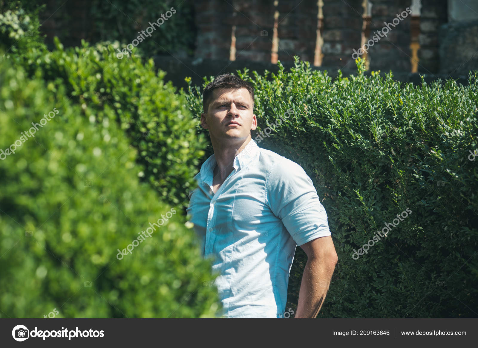 bb1809c5d0 Handsome guy on summer vacation. Man enjoy summer day in park. Macho with  young face. Model wear fashionable shirt on sunny outdoor. Youth fashion  concept.
