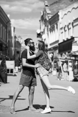 romantic couple in love embrace, kiss and dance in street