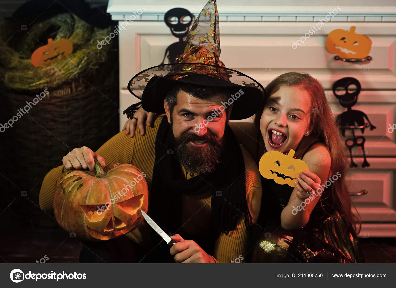 Father And Daughter With Halloween Decor Wizard And Little