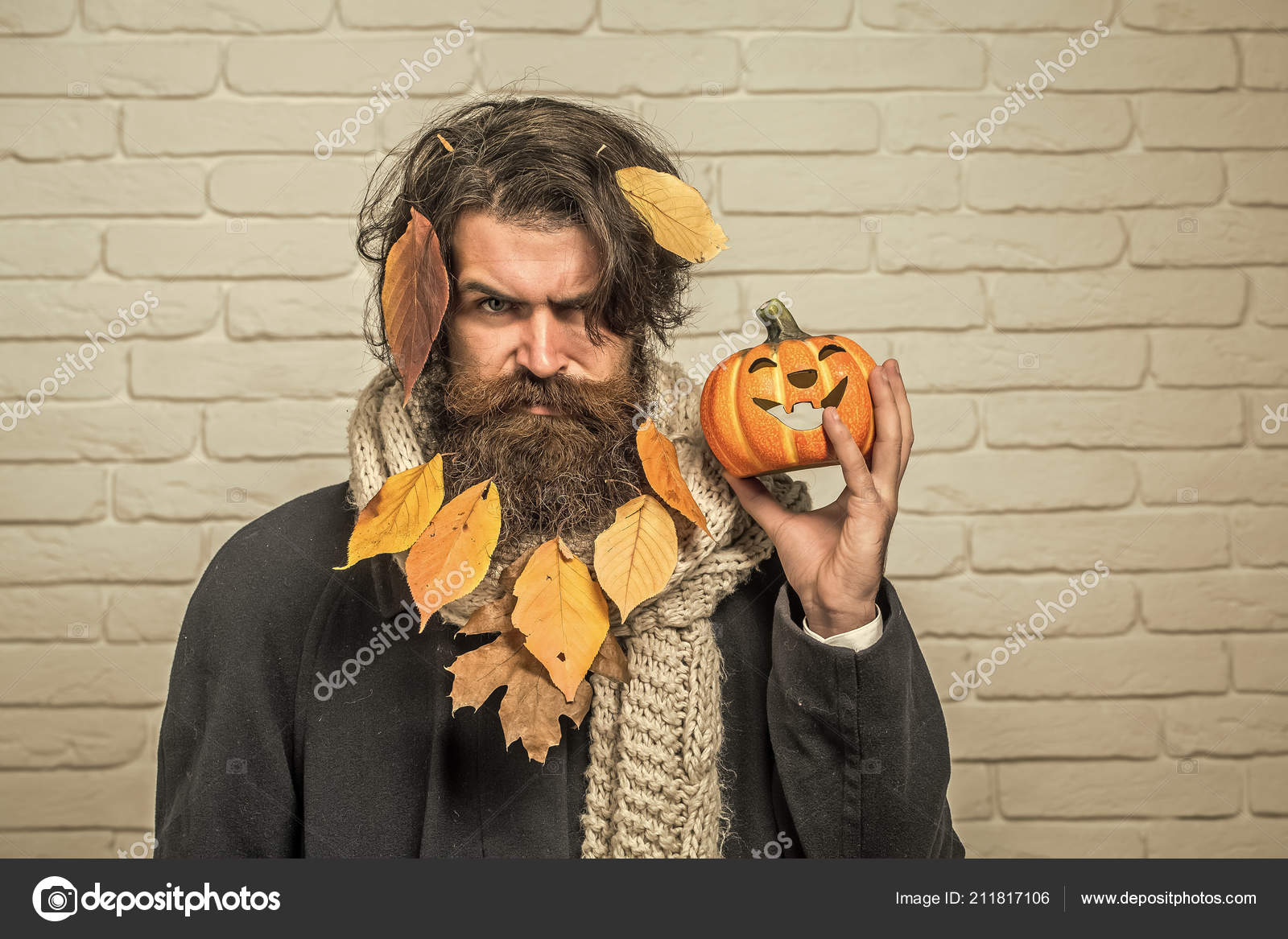 Halloween Hipster With Yellow Leaves In Beard Hair Stock