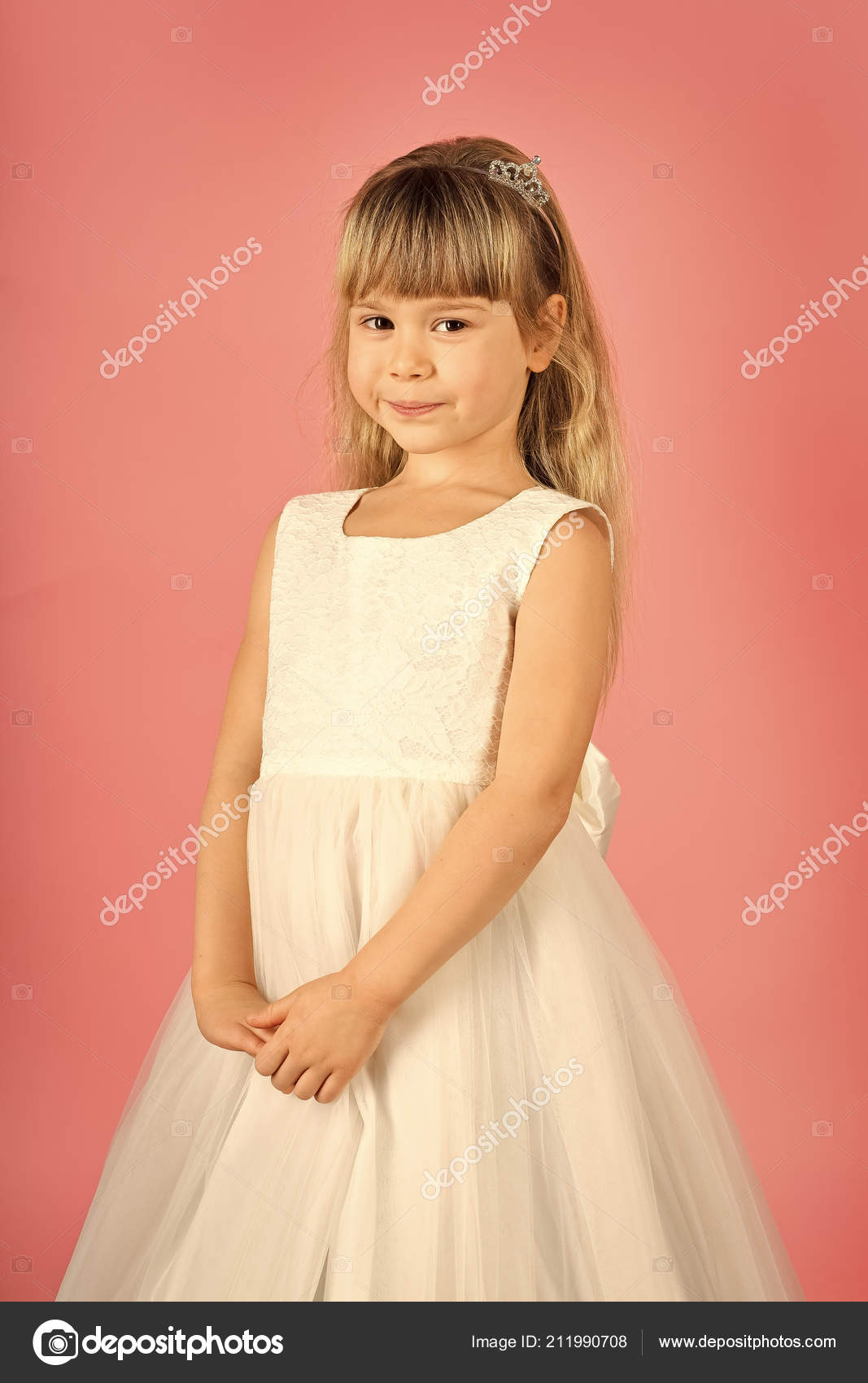 a7854a6e6f79 Look, hairdresser, makeup. Child girl in stylish glamour dress, elegance.  Fashion and beauty, little princess. Little girl in fashionable dress, prom.