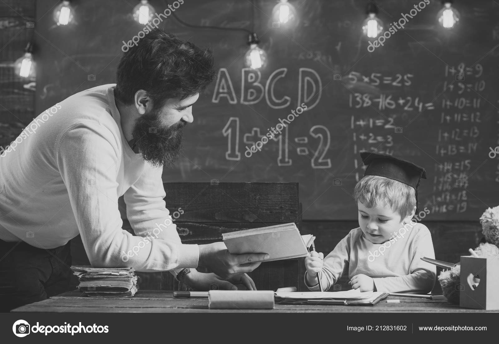 wunderkind and genius concept father teacher reading book