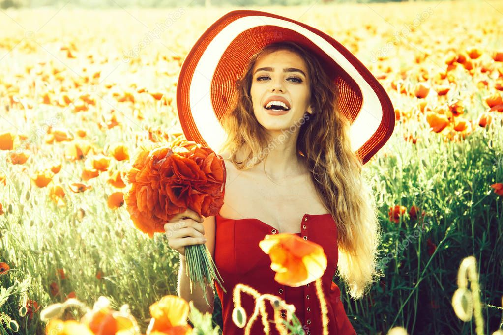flower bouquet at smiling girl in retro hat, poppy field