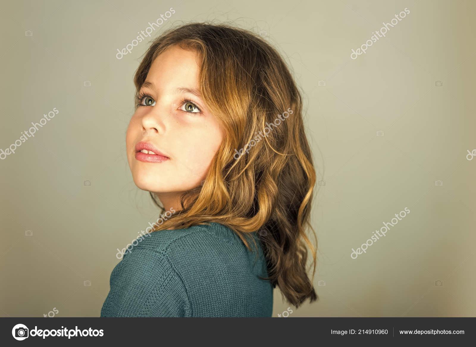 8440de805 Cute little baby girl fashion pretty model dark blonde curly lady hair  funny child birthday party fun children– stock image