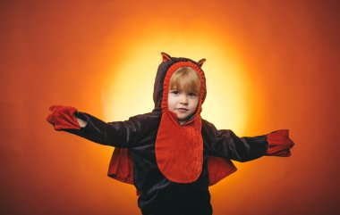 Little cute Boy wearing hallowwen carnival costumes. Halloween decoration and scary concept. Halloween background. 31 october.