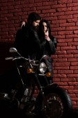 Photo fashion couple. fashion couple at cool motorbike. sexy couple in fashion leather jacket. fashion couple concept. love their style.