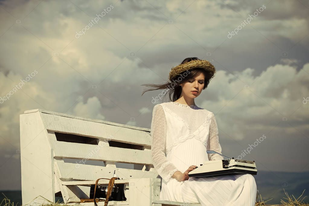 Girl in wreath and white dress on bench