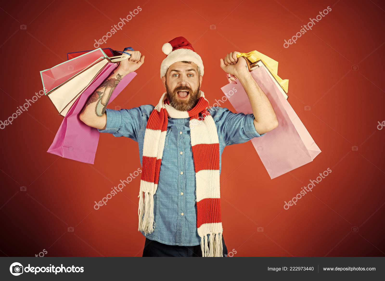 3927ed4fe779d depositphotos 222973440-stock-photo-christmas-man-shopper-happy-shout.jpg