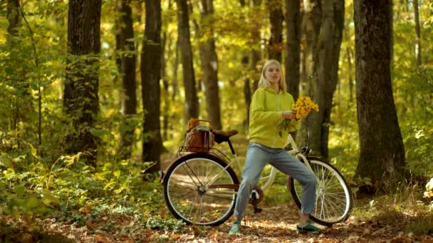 Funny expression and crazy people. Autumn happy girl and joy. Carefree woman. Autumn woman with retro bike with flowers in basket in autumnal park.