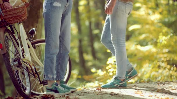 Romantic Autumn Couple in Love. Sensual woman and young man in autumn forest.