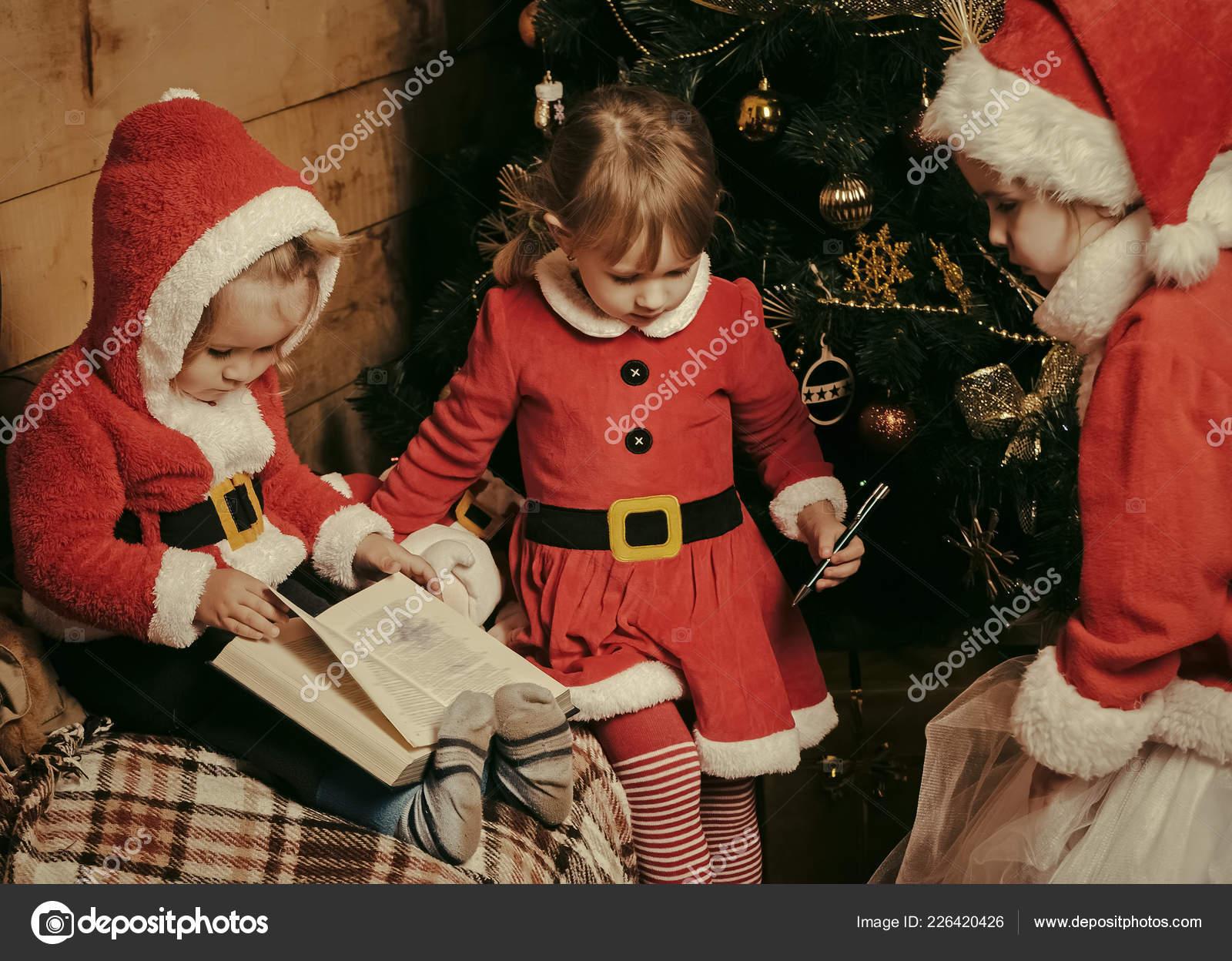 Santa claus kid at Christmas tree. — Stock Photo © Tverdohlib.com ...
