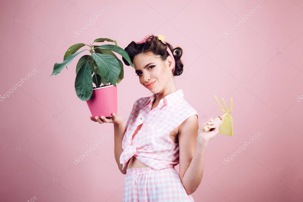 Taking care for environment. greenhouse worker or gardener. pin up woman with trendy makeup. spring. pinup girl with fashion hair. retro woman growing plants. Garden. pretty girl in vintage style