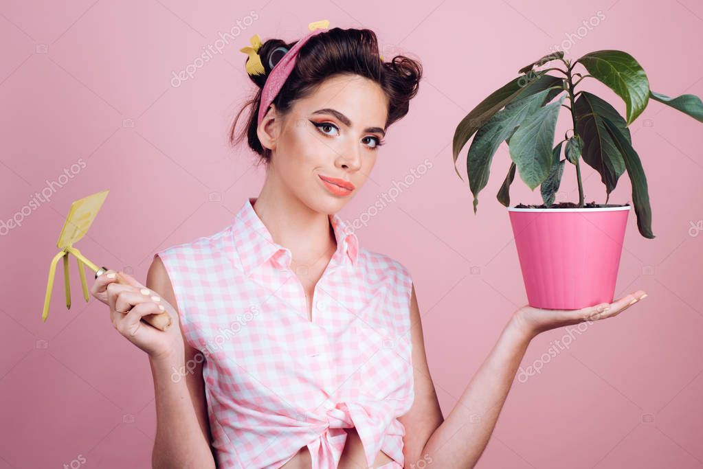 Gardening is more than hobby. pretty girl in vintage style. pin up woman with trendy makeup. pinup girl with fashion hair. greenhouse worker or gardener. retro woman growing plants. Garden. spring