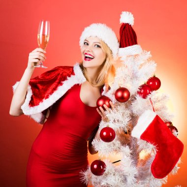 Blonde girl celebration on red background. Champagne new year party. Pretty girl wish merry Christmas and happy new year. Christmas girl concept. Girl surprise. Festive champagne.