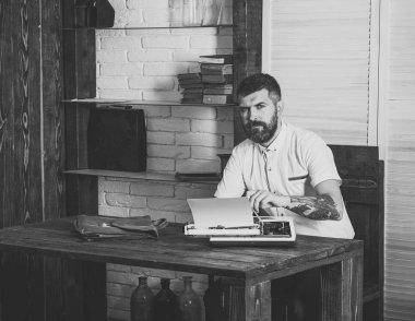 Hipster type on vintage typewriter at desk