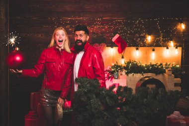 Sexy couple in a Night Club. Winter holidays and people concept. Greatest Love Stories. Christmas man suit fashion. Christmas bomb. Creative boom.