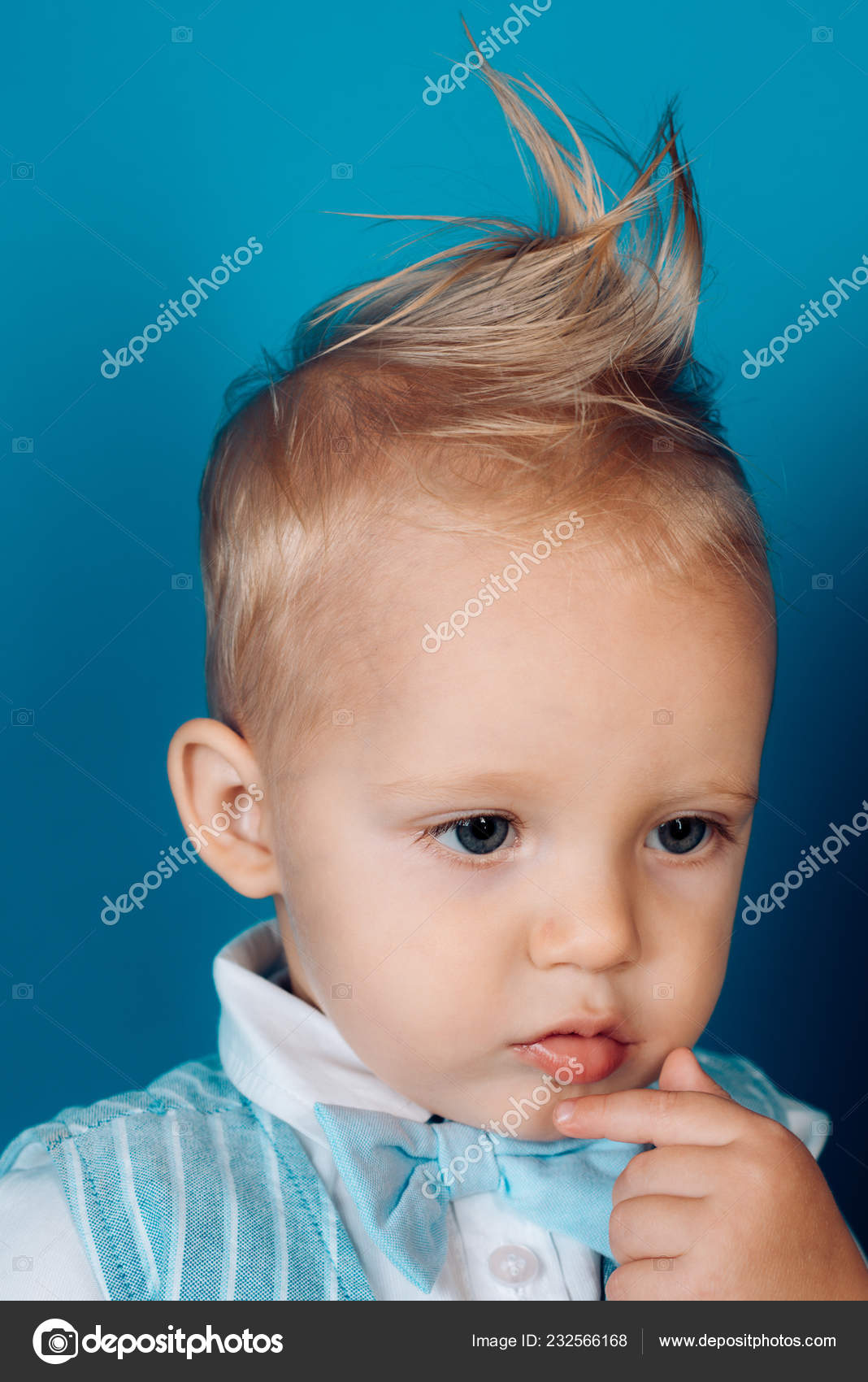 Having A Modern Haircut Boy Child With Stylish Blond Hair Small