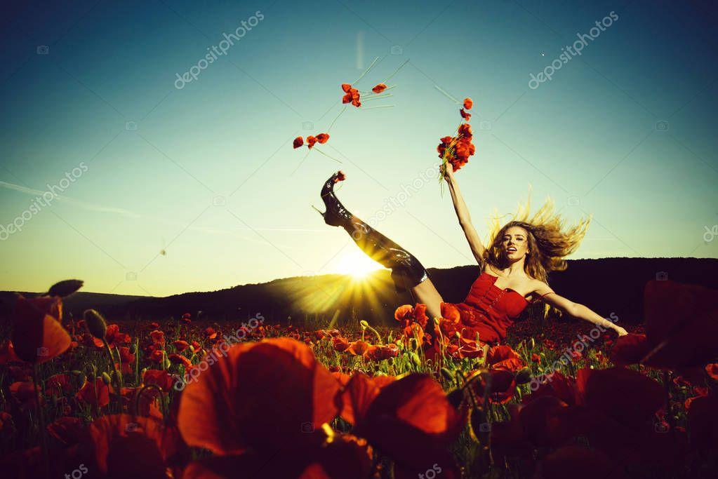 dancing girl in field of poppy seed