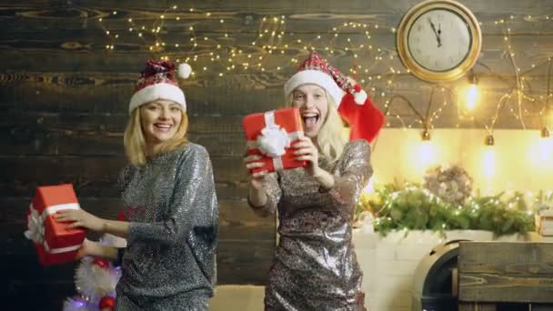 Crazy For Christmas.Dancing Girls With Christmas Gifts Crazy Women On Christmas Background With Gift Boxes Two Women Celebrating At New Year Party Happy Laughing Girls In Casual Dresses