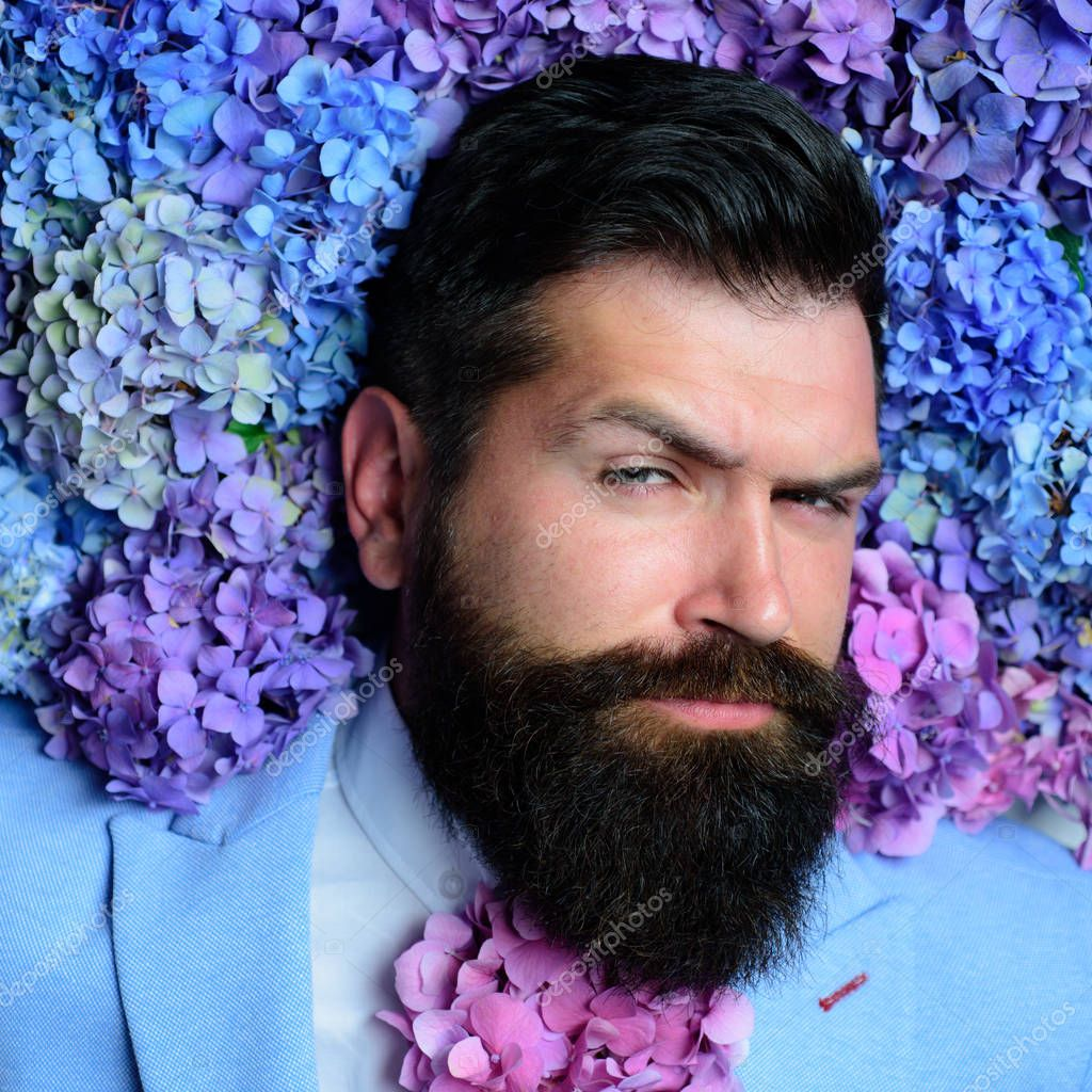 Bearded man. Summer. brutal caucasian hipster with moustache. male with hydrangea flowers. spring. womens day. Mature hipster with beard. Healthy hair and skin. Ambitious and handsome