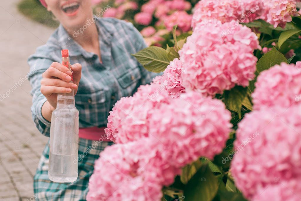 happy woman gardener with flowers. Greenhouse flowers. Flower care and watering. soils and fertilizers. hydrangea. Spring and summer. woman care of flowers in garden. Flowers need good care