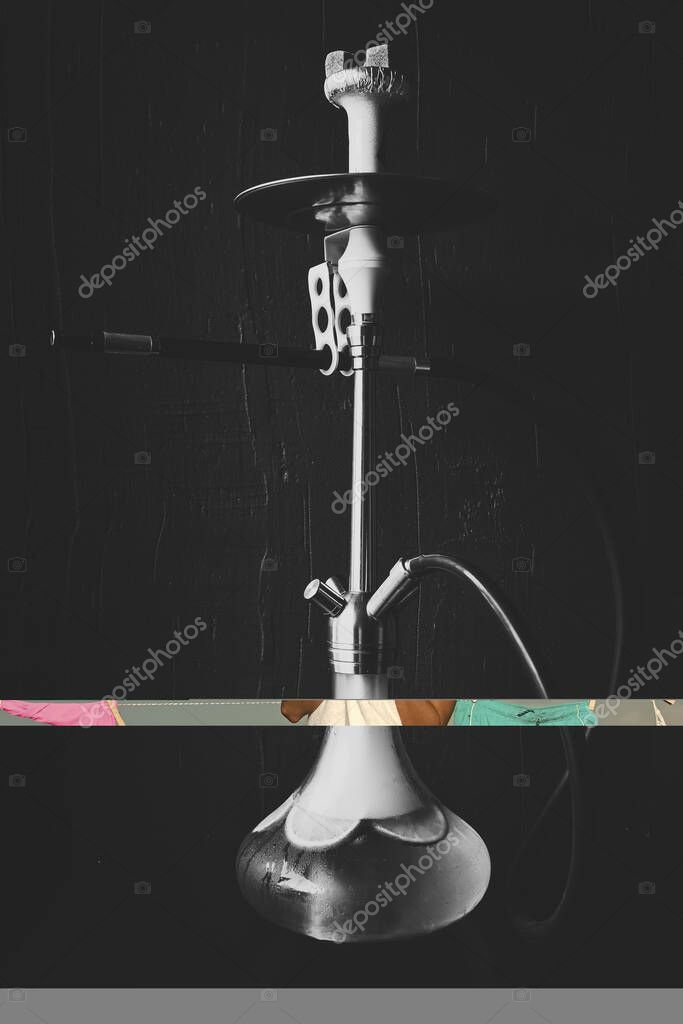 Hookah of glass and metal on dark background