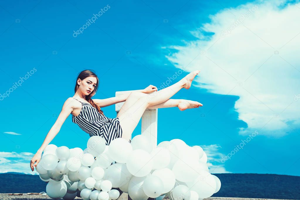 woman in summer dress with party balloons. Fashion portrait of woman. inspiration and imagination. girl sit in sky. feeling freedom and dreaming. Ambitious and beautiful