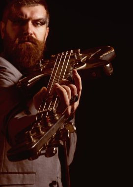 Guitar player hold electric instrument. Bearded man play guitar chord. Musician with guitar. My guitar gently weeps
