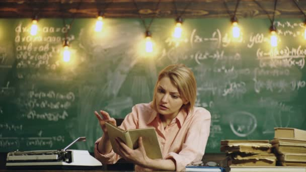 Woman learning lessons. Schoolgirl studing at school at the table, childrens education, back to school. Learning concept. Teacher in classroom. Teacher and student.