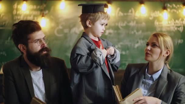 Child in big suit coat and graduation cap. Education in primary school. Professional tutors are experts in their academic content. Education and school concept. Teacher and student. Back to school.