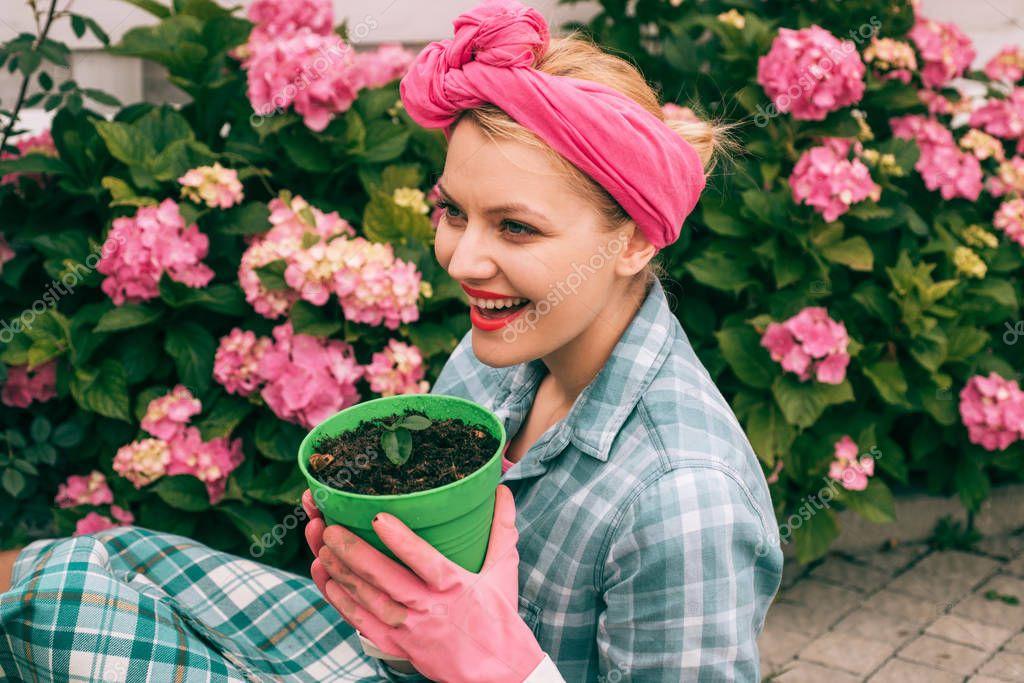 Flower care and watering. soils and fertilizers. hydrangea. Spring and summer. Greenhouse flowers. happy woman gardener with flowers. woman care of flowers in garden. Love my work