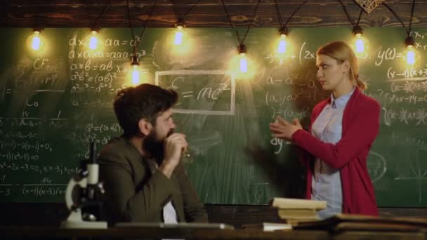 Education, school, college and university concept. Teacher and female student solve mathematical formulas and record them with chalk on board. Classmate Classroom Sharing International Friend Concept.
