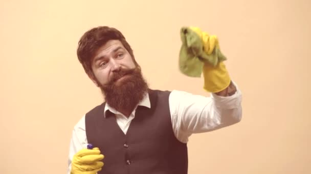 Cleaning service man. Professional window cleaner. Bearded man with cleaning agents working. Portrait of man with cleaning equipment cleaning the house.