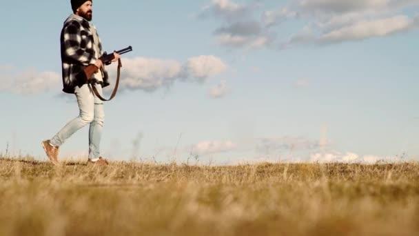 Duck hunting. Man holding shotgun. Hunter with a shotgun in a vintage shooting clothing.