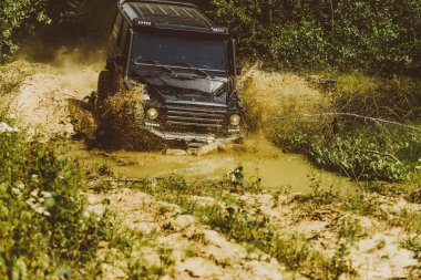 Offroad travel on mountain road. Track on mud. Best Off Road Vehicles. 4x4 Off-road suv car. Offroad car. Safari. Tracks on a muddy field. Road adventure. Adventure travel.