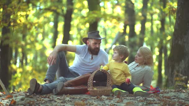 Parents with Children in Countryside. Autumn day. Mother and father with son having fun outdoor. Cheerful family having fun outdoors. Autumn Family.