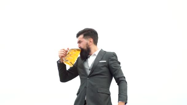 Retro man with a beer. Man with beard holds glass of beer. Bearded handsome man holding glass of beer. Concept of craft beer.