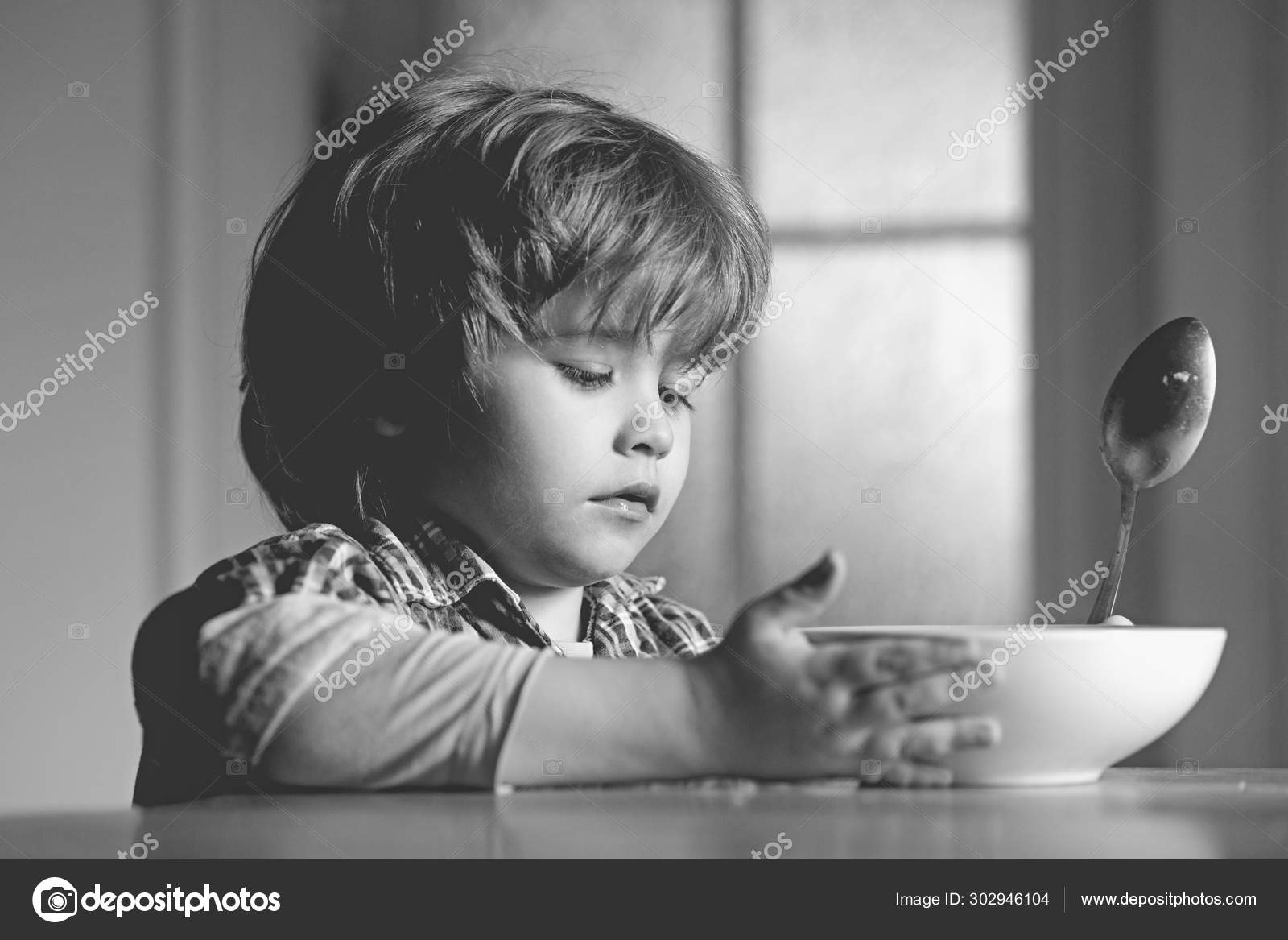 Kid Boy Eating Healthy Food At Home Good Morning In Happy Family Little Boy Sitting At The Table And Eating Milk Snack Stock Photo C Tverdohlib Com 302946104